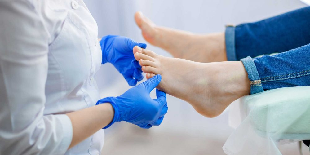 A podiatrist treating feet