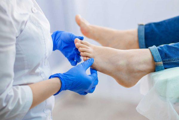 A podiatrist treating feet