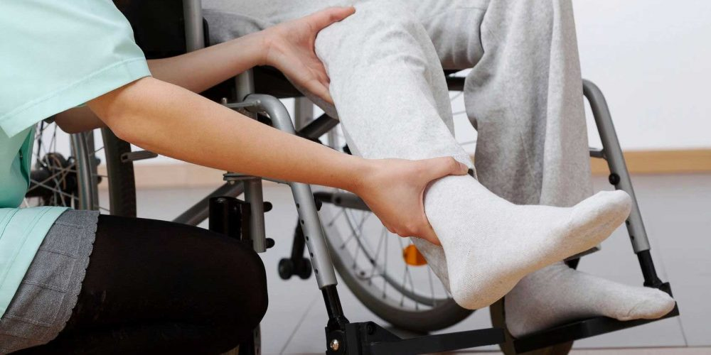An occupational therapist prescribing wheelchair adjustments