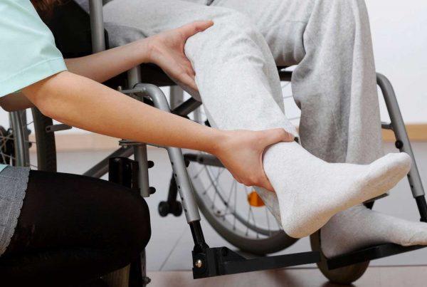 An occupational therapist prescribing wheelchair adjustments